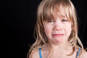 crying-child-on-black